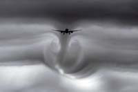 Fear of flying. Enhanced picture showing the disturbed airflow behind an aircraft.